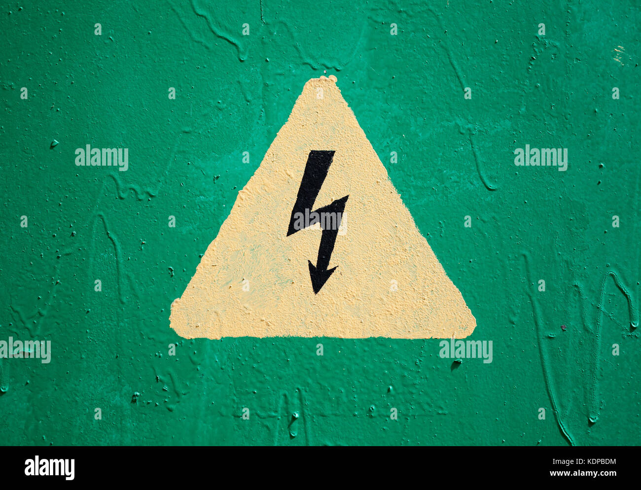 Electricity symbol power lightning sign safety warning danger stock yellow high voltage triangle warning sign on green metal wall stock image buycottarizona Images