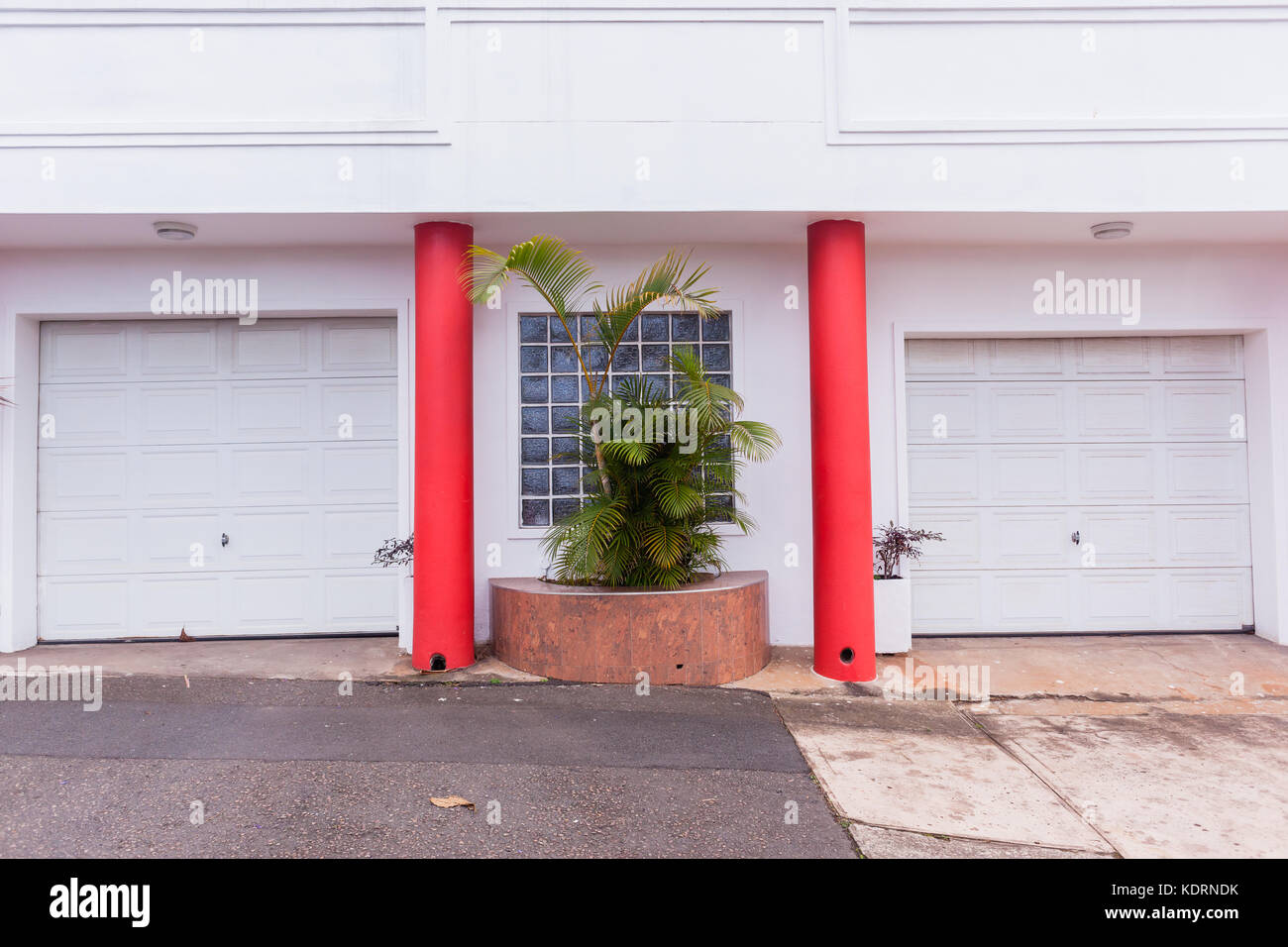 Red garage doors stock photos red garage doors stock images alamy double garage doors white with red columns outside road entrance for vehicles stock image rubansaba