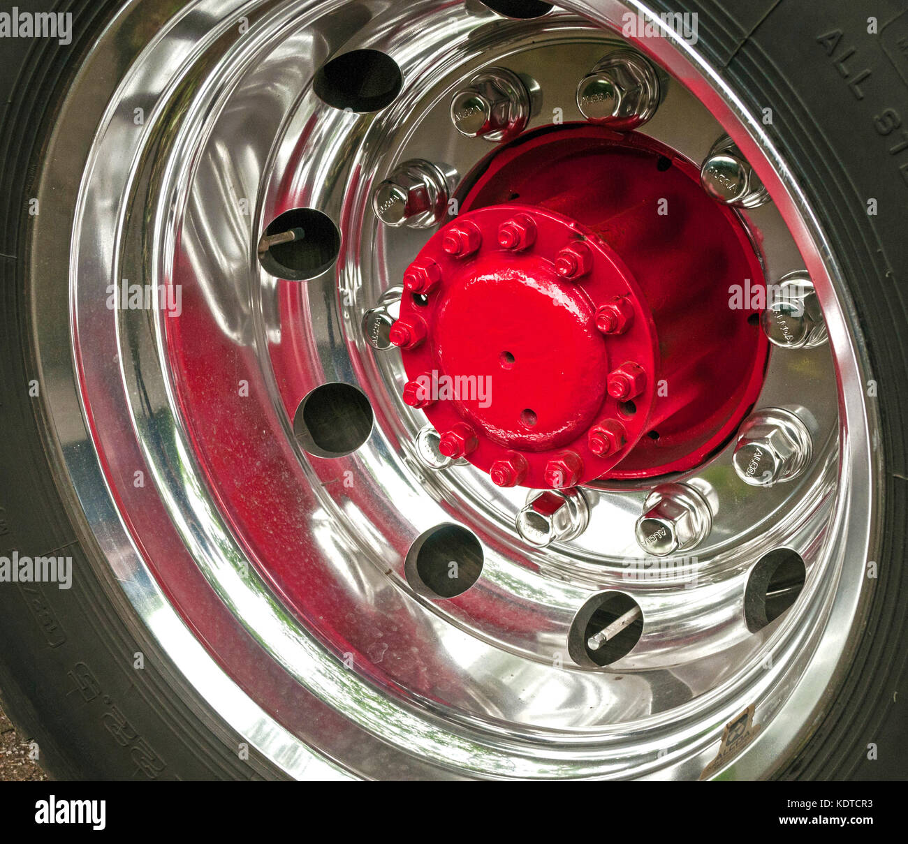 silver chrome truck lorry wheel with red centre hub stock image