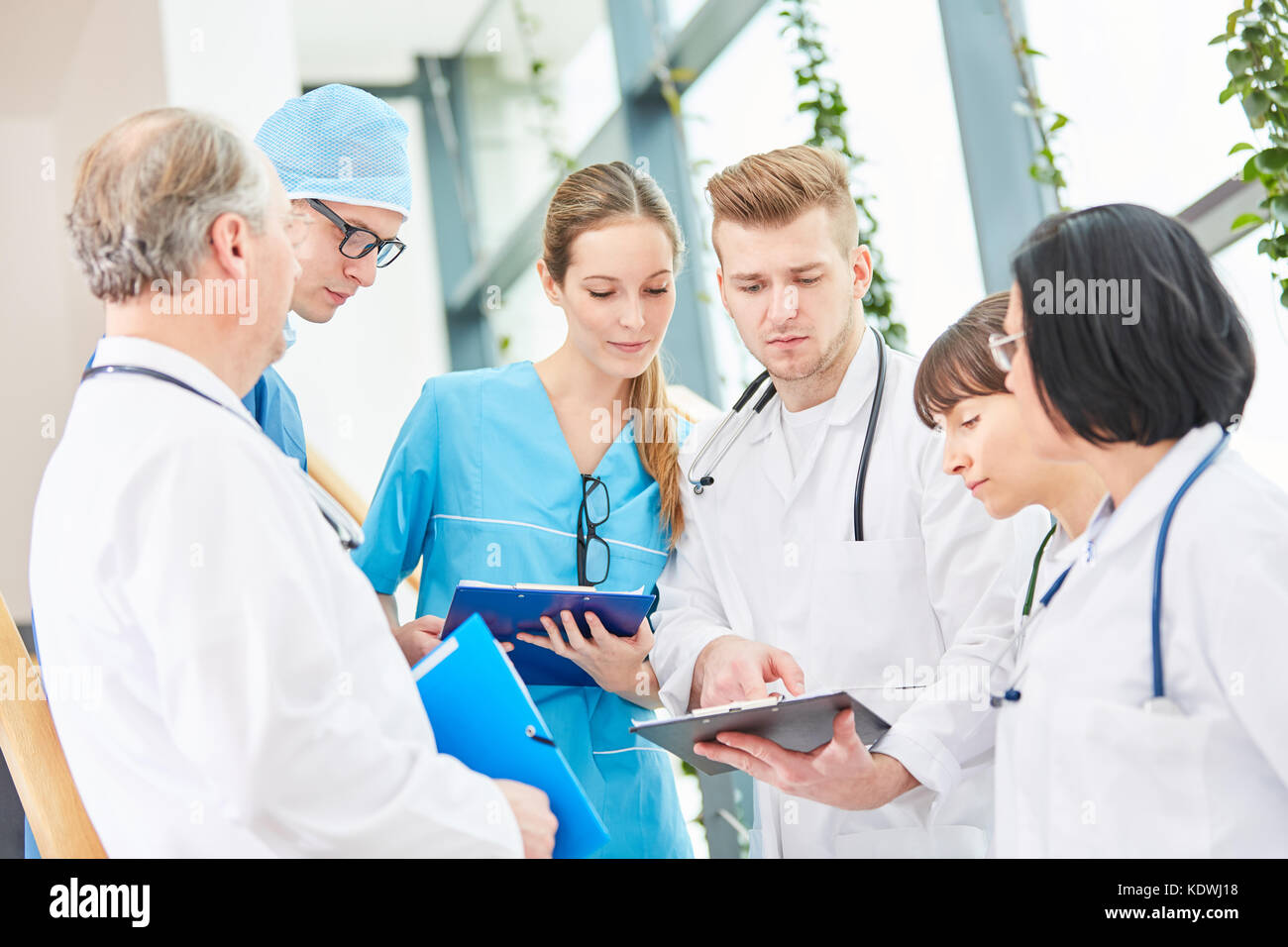 Team Of Doctors Planning Surgery With Surgeon And Surgical Nurse