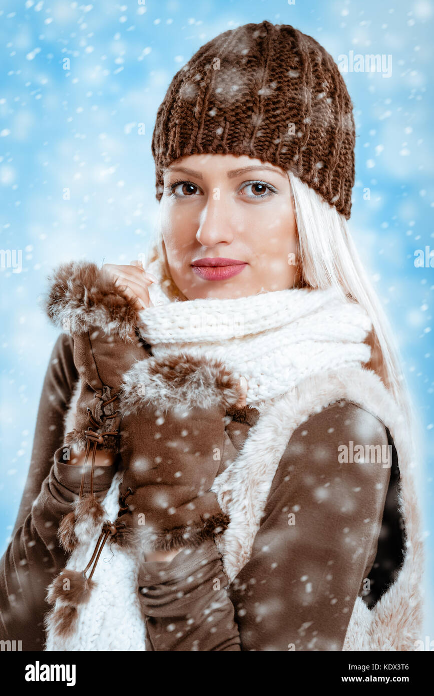 c3dcfac6983b Beautiful young girl in winter clothes with a wool cap and fur Stock ...