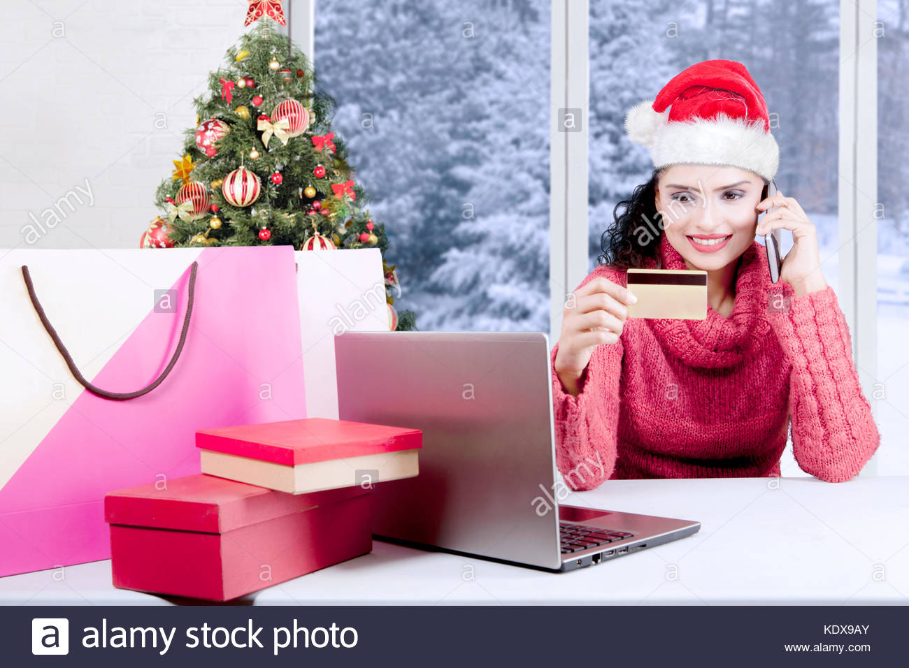 Buying Christmas Gifts Stock Photos & Buying Christmas Gifts Stock ...