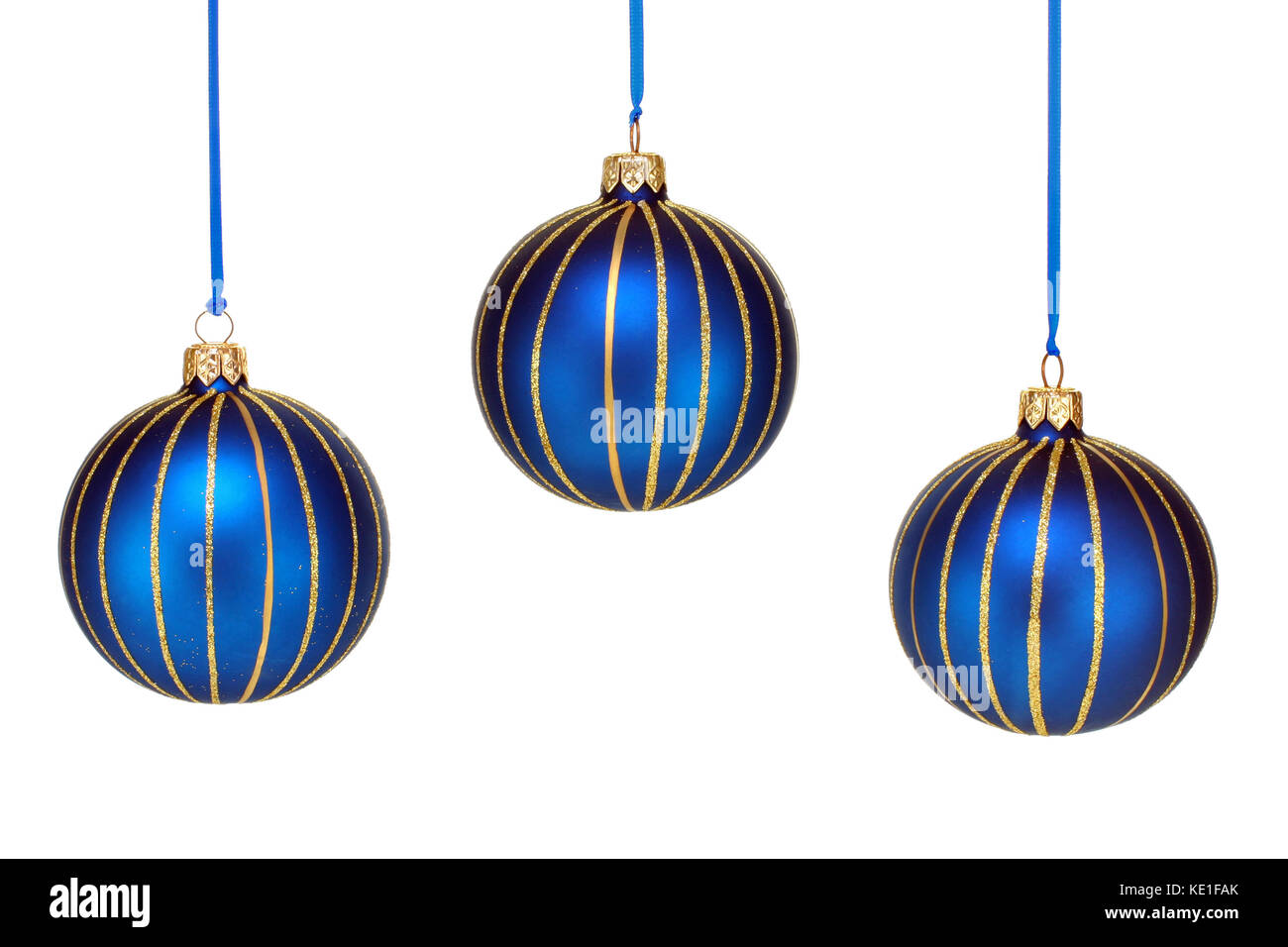 three blue and gold christmas ornaments hanging against a white background
