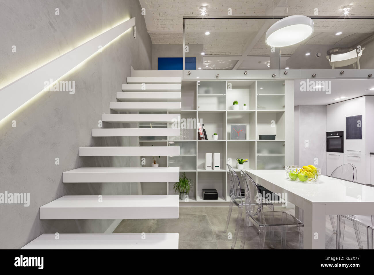 Loft apartment with white, modern, mezzanine stairs with led light ...