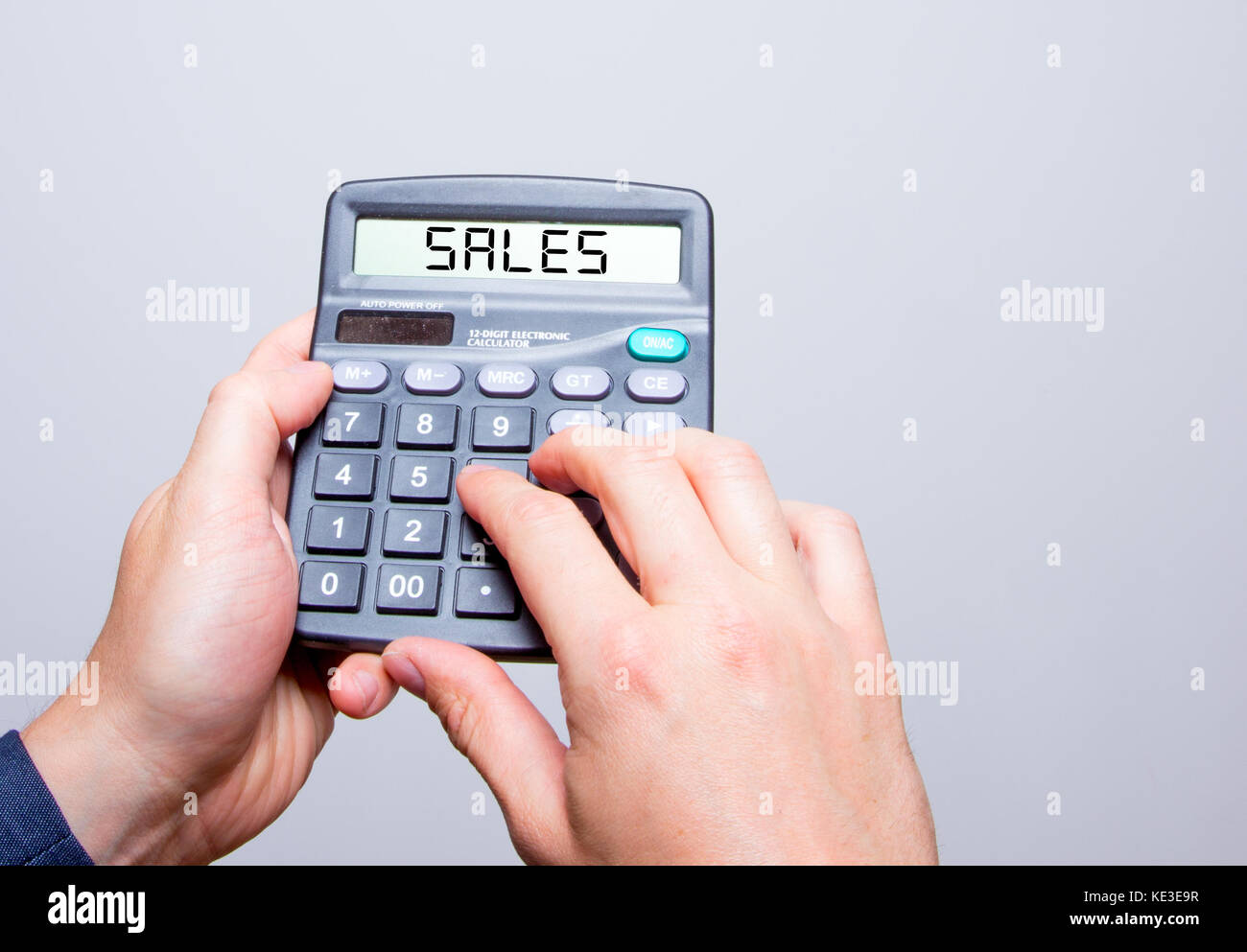 businessman hands holding calculator with sales sign text message