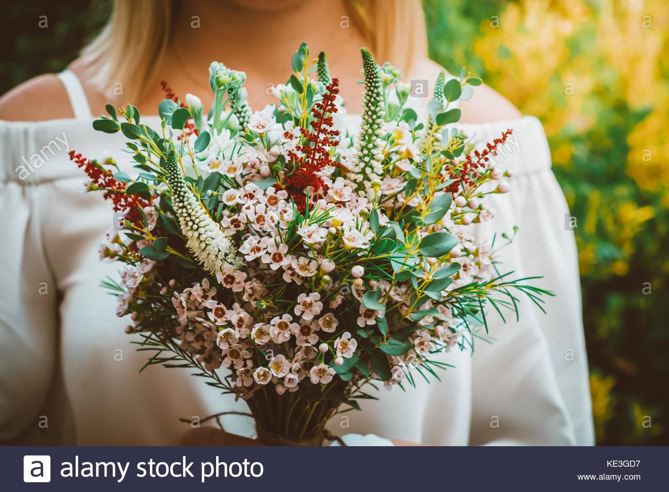 Bohemian bride showing off her beautiful boho wedding flower bouquet ...