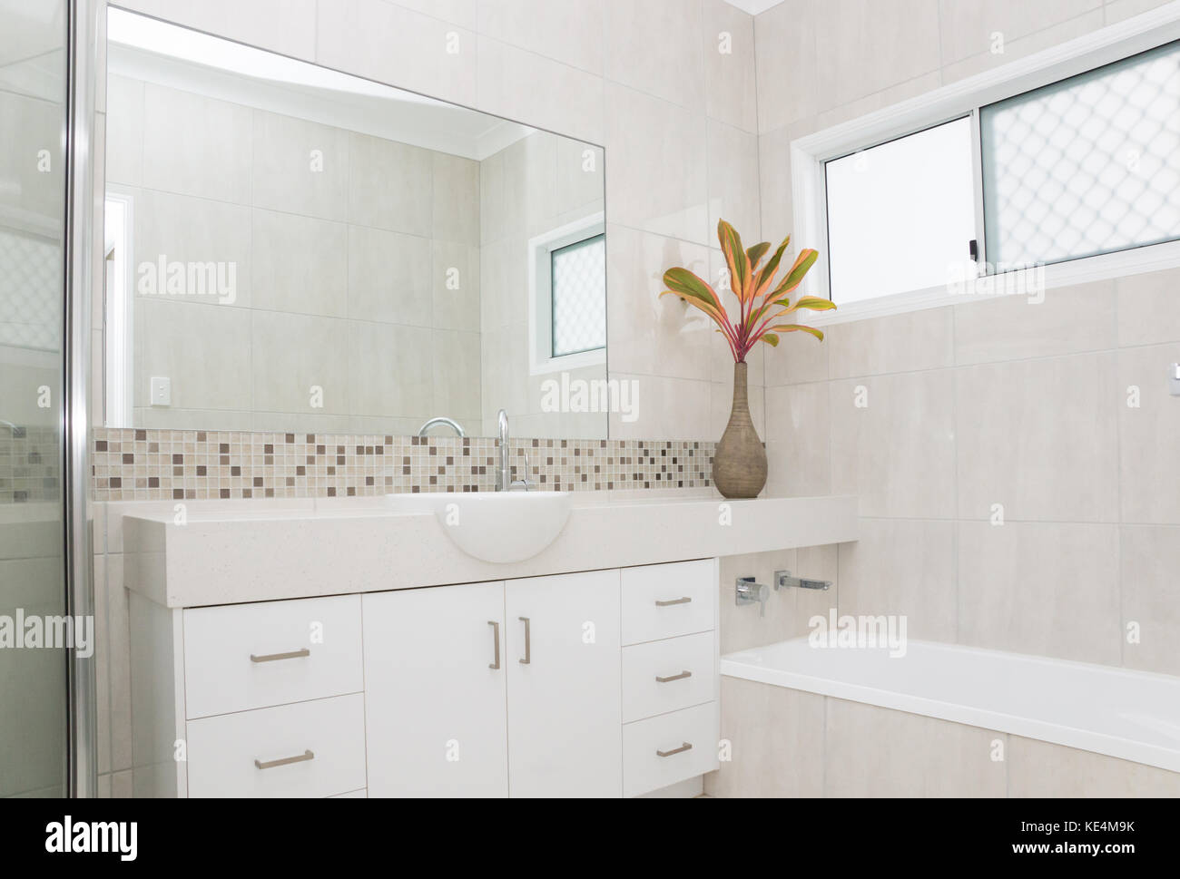 Modern bathroom with granite bench and tiled walls Stock Photo ...