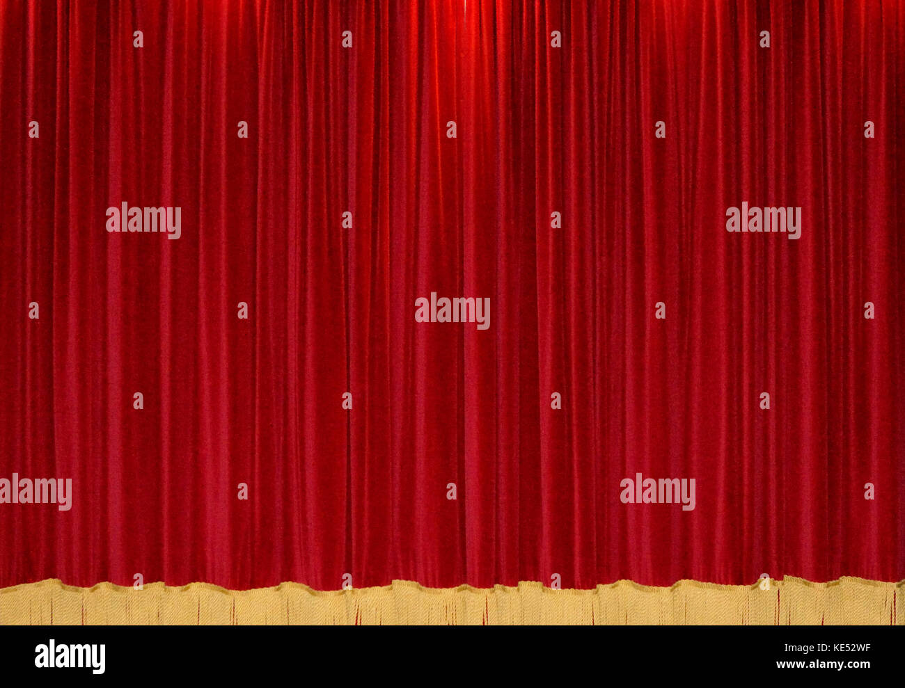 Closed theater curtains - Velvet Red Curtains Closed Curtains With A Gold Trimming At The Bottom Stock Image