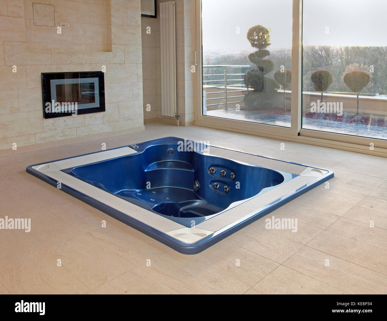 Large hot tub built in flor of room interior Stock Photo: 163691448 ...