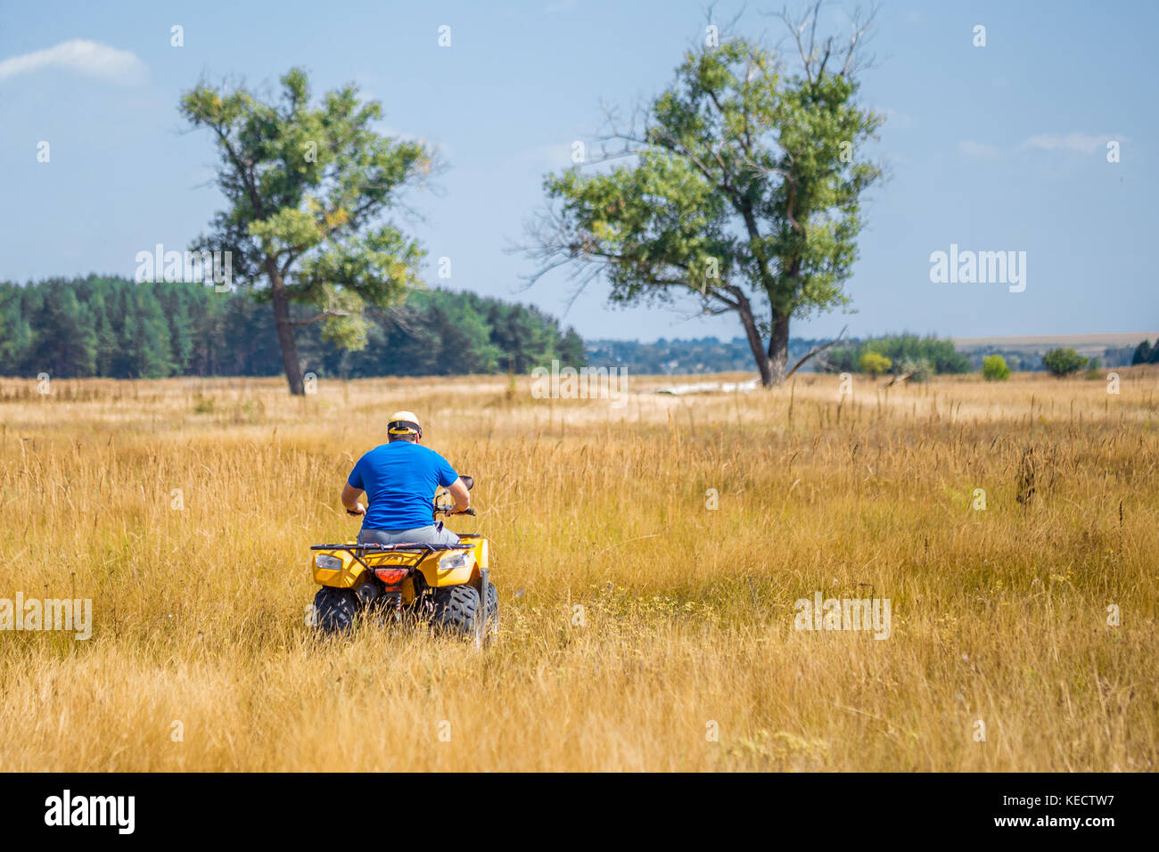 Caucasian Man In Sport Protective Goggles Riding An Atv Quad Bike