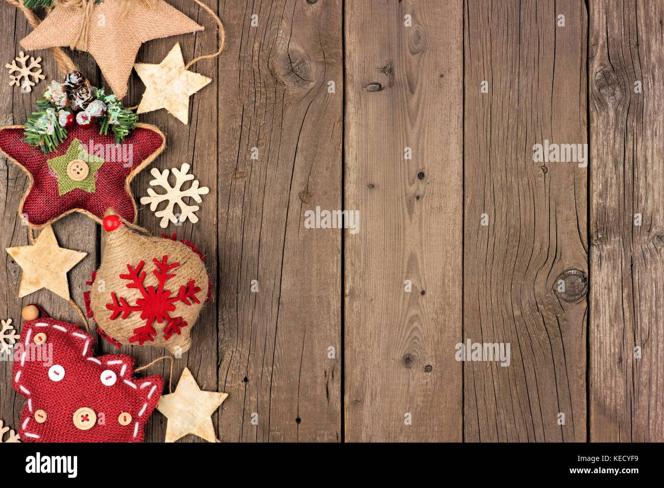 Rustic Christmas side border with wood ornaments and berries on an ...