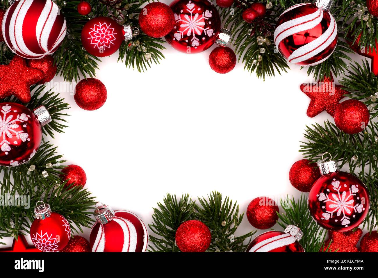 Christmas frame of red and white baubles with branches isolated on a ...