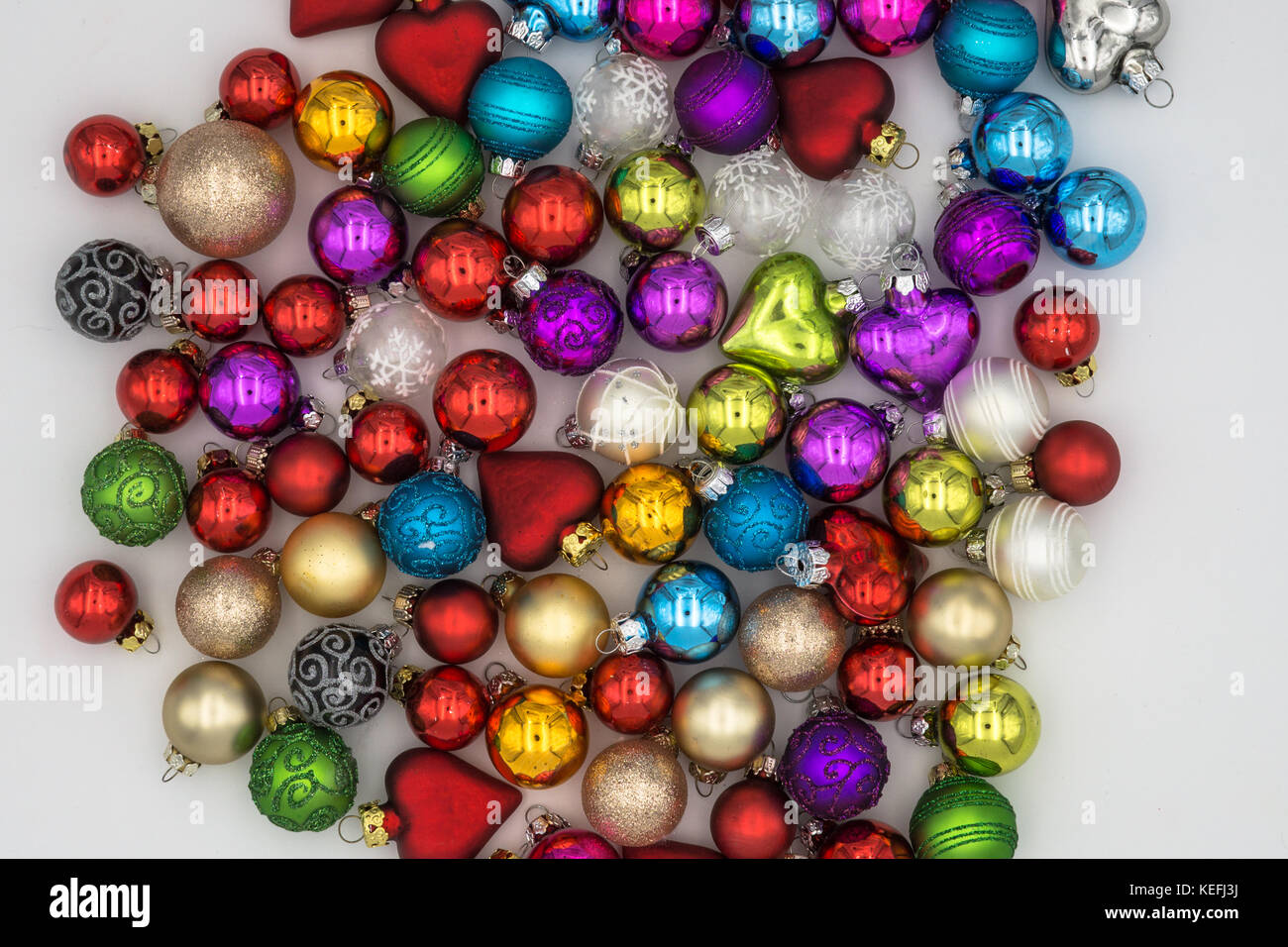 Christmas Background Theme Multicolored Christmas Balls Red Blue Green Silver Gold Purple Yellow On A White Background