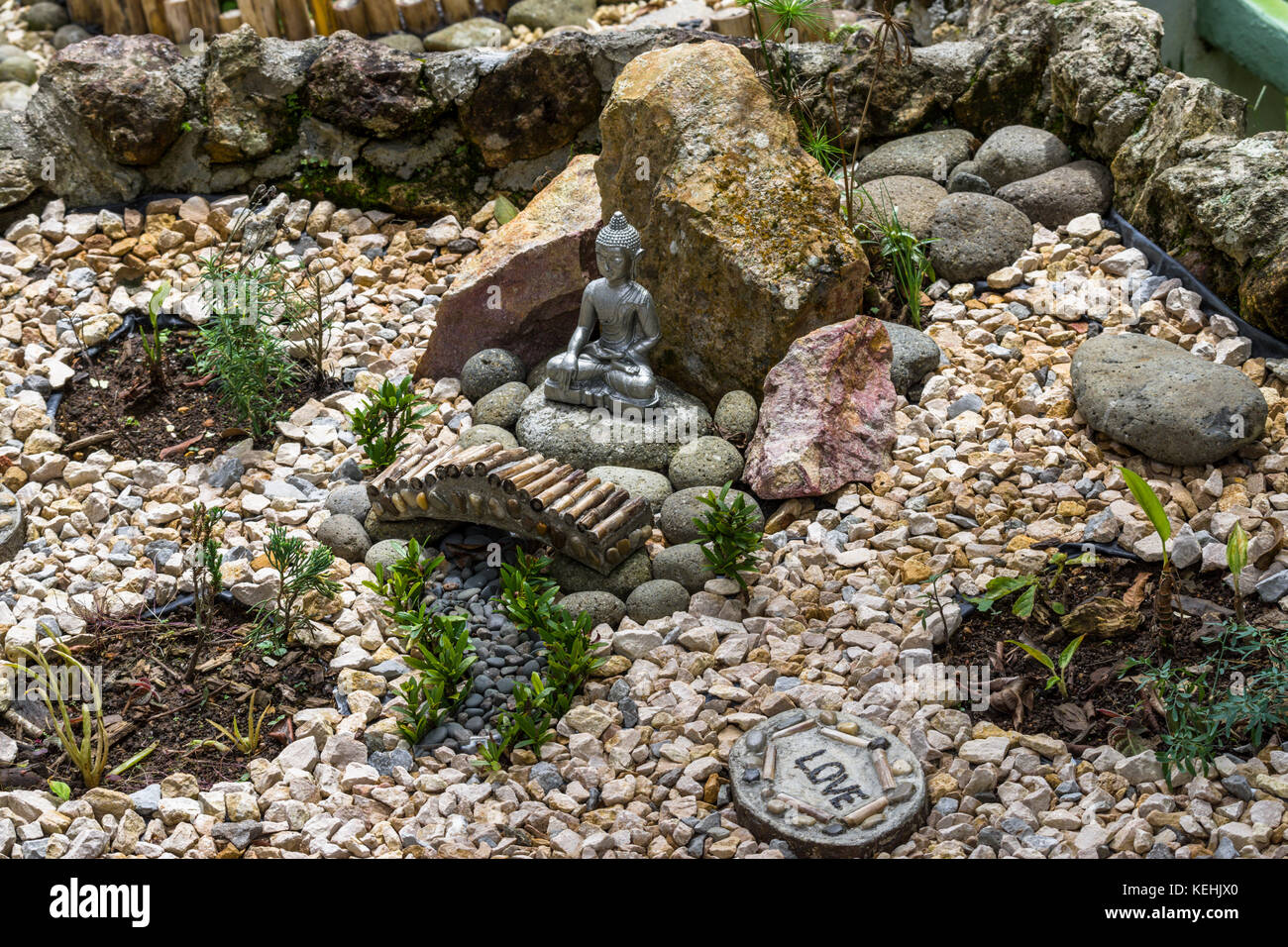 Garden Ideas Zen Stone Garden With Small Sitting Buddha Statue Stock - Stone-garden-ideas