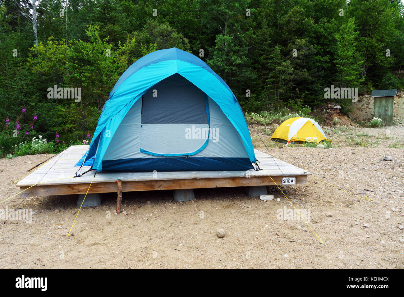 Tent pitched on a wooden platform & Tent pitched on a wooden platform Stock Photo Royalty Free Image ...