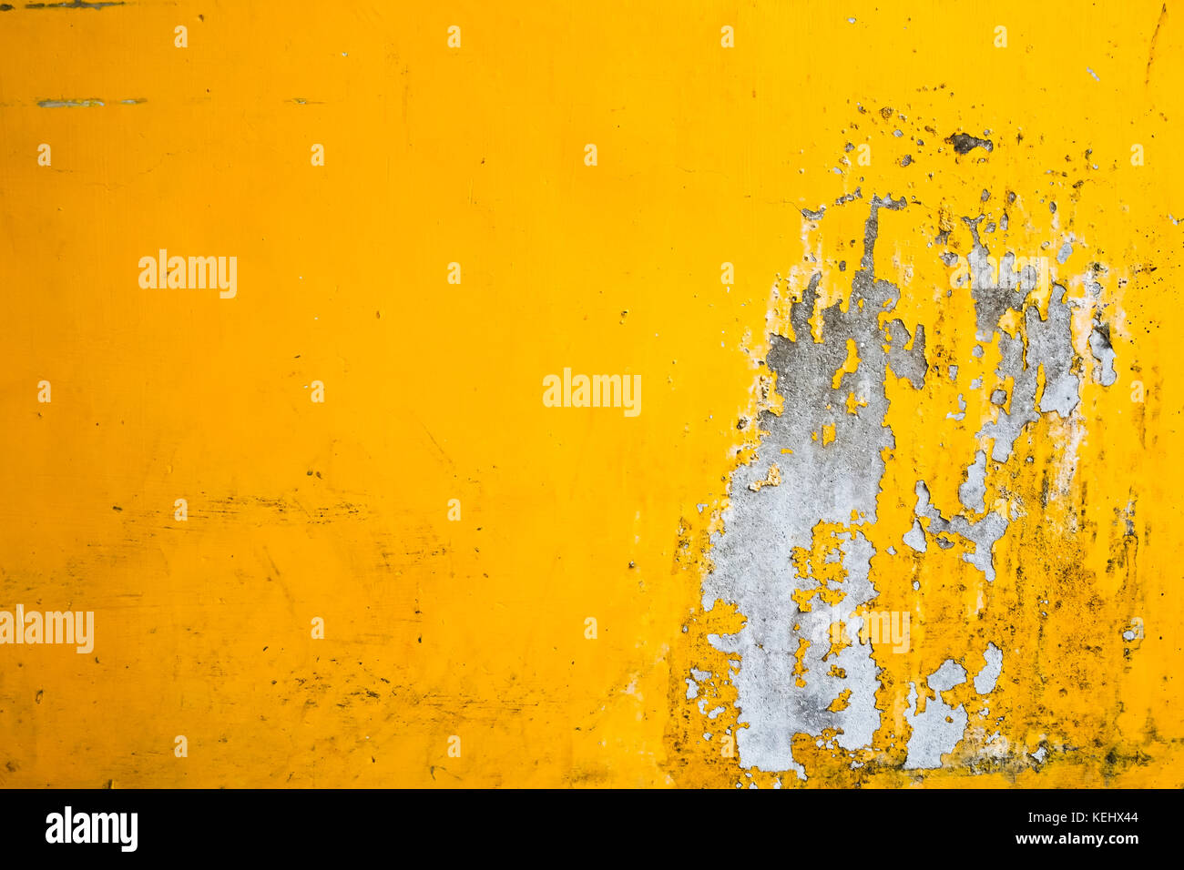 Cracked paint on old yellow wall texture Stock Photo: 163892180 - Alamy