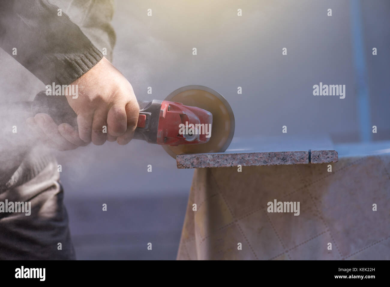 Electric tile cutter stock photos electric tile cutter stock grinder worker cuts stone block with electric hand saw stock image dailygadgetfo Image collections