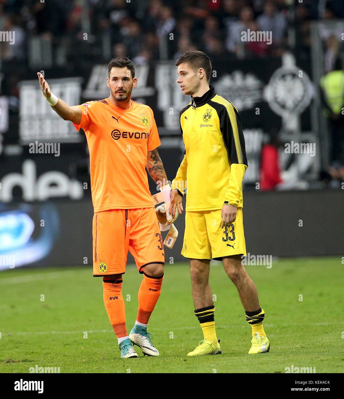 Dortmund s goalkeeper Roman Buerki L and Julian Weigl R react