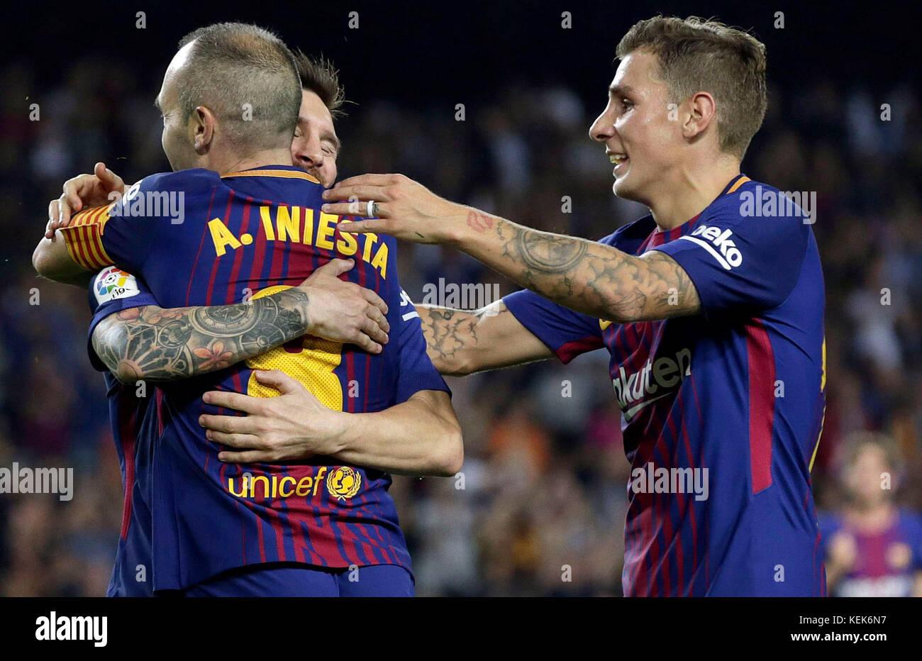 FC Barcelona s Spanish midfielder Andres Iniesta L jubilaetes