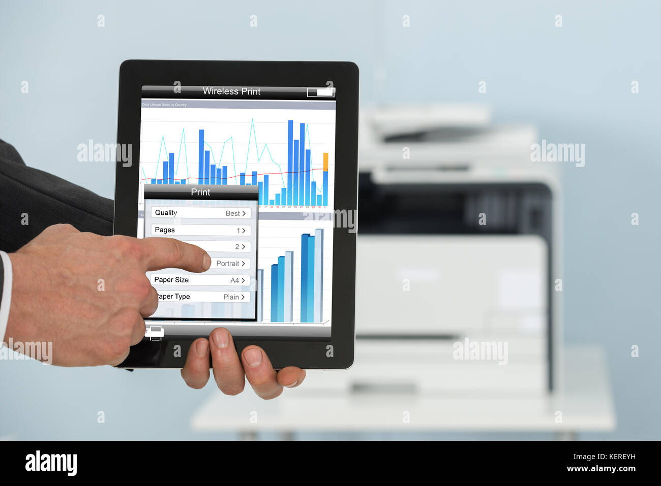 close up of businessman holding tablet for printing graph paper