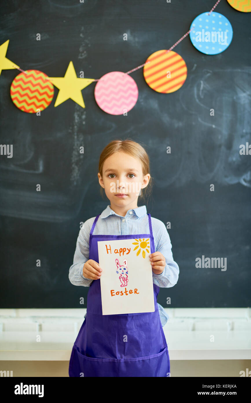 Little girl holding easter gift card stock photo royalty free little girl holding easter gift card negle Choice Image