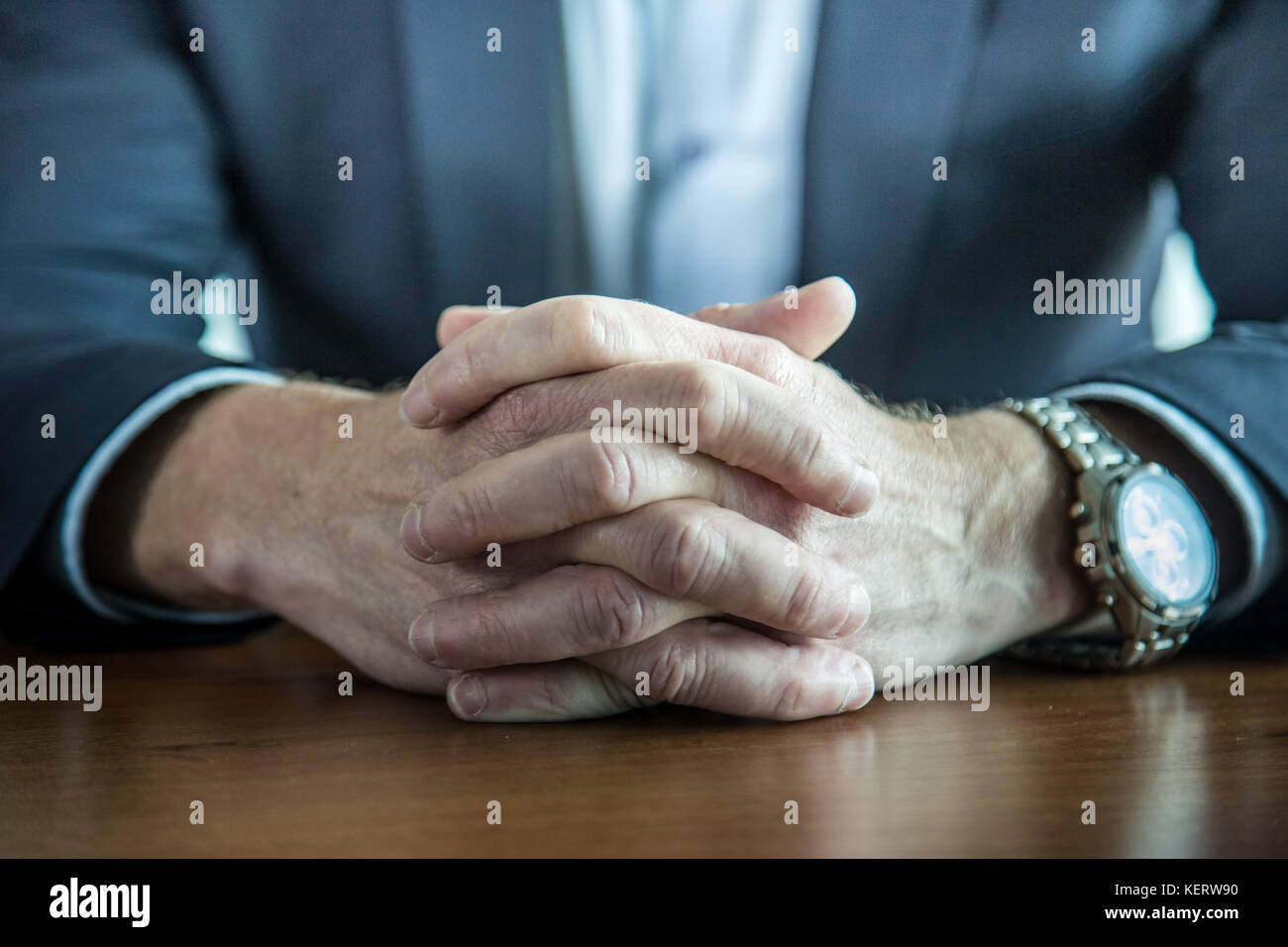 Close Up Of Businessman Keeping Hands With Fingers Crossed On The
