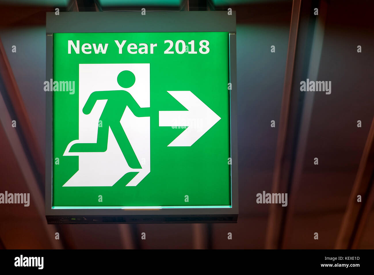 The emergency exit sign shows the direction of escape for happy new the emergency exit sign shows the direction of escape for happy new year the board pointing way to new year 2018 buycottarizona Images