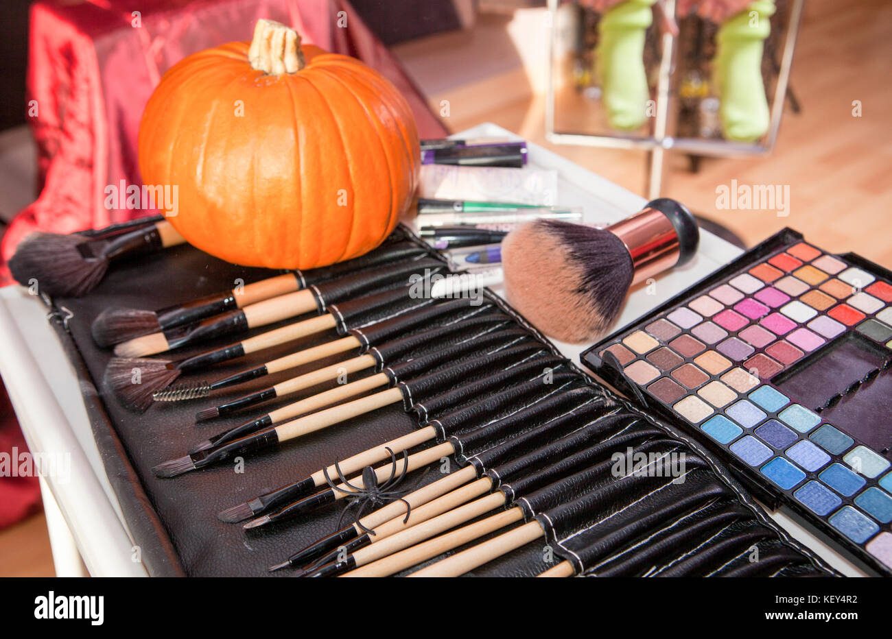 Set of brushes for makeup in a black cover with pumpkin