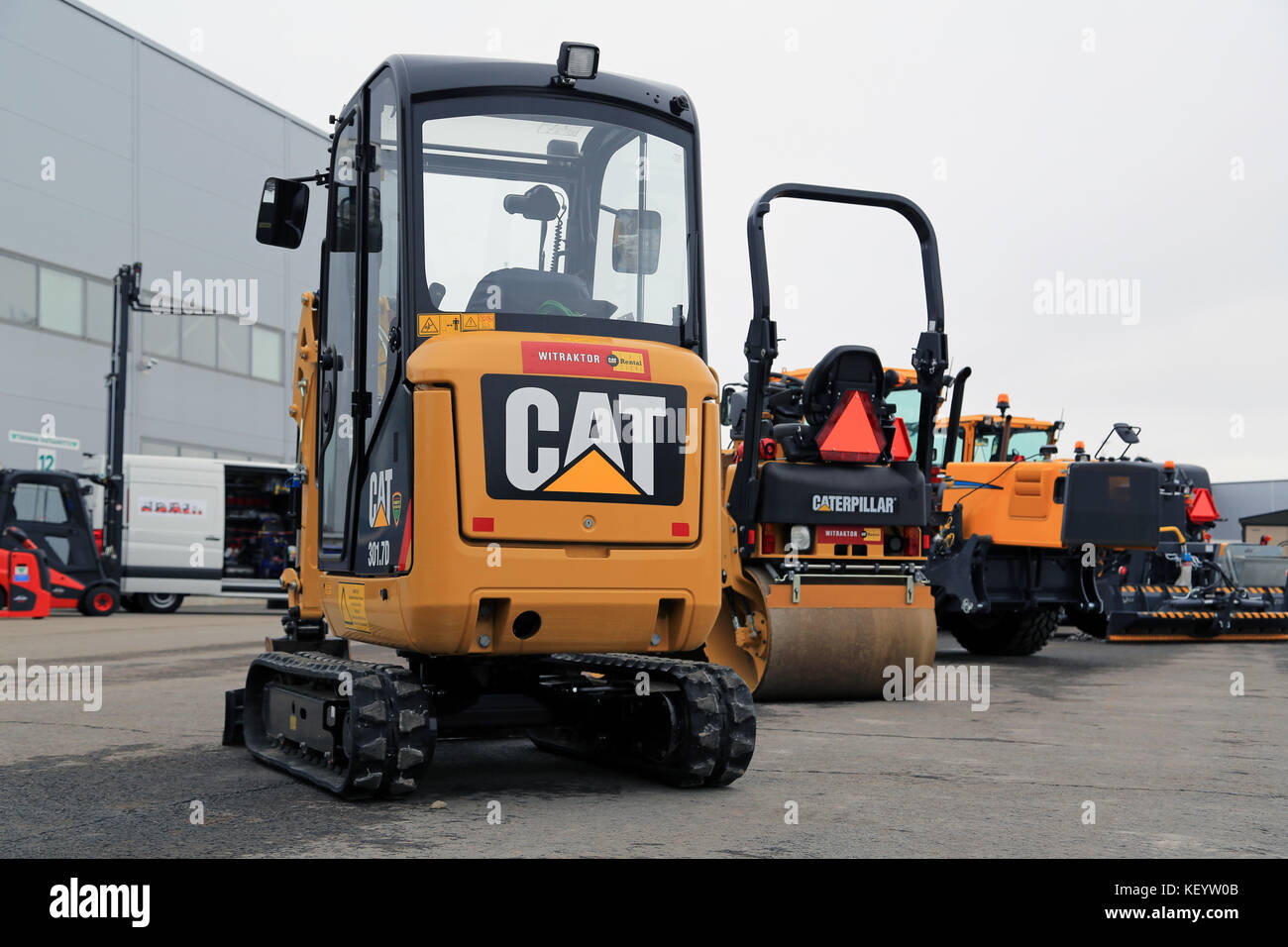 lieto finland march 12 2016 cat 3017d mini hydraulic excavator and KEYW0B construction vehicle and cat stock photos & construction vehicle  at gsmportal.co