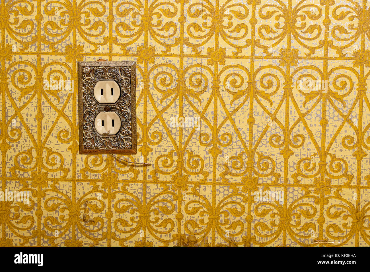 AC power plug installed in yellow decorative wall Stock Photo ...