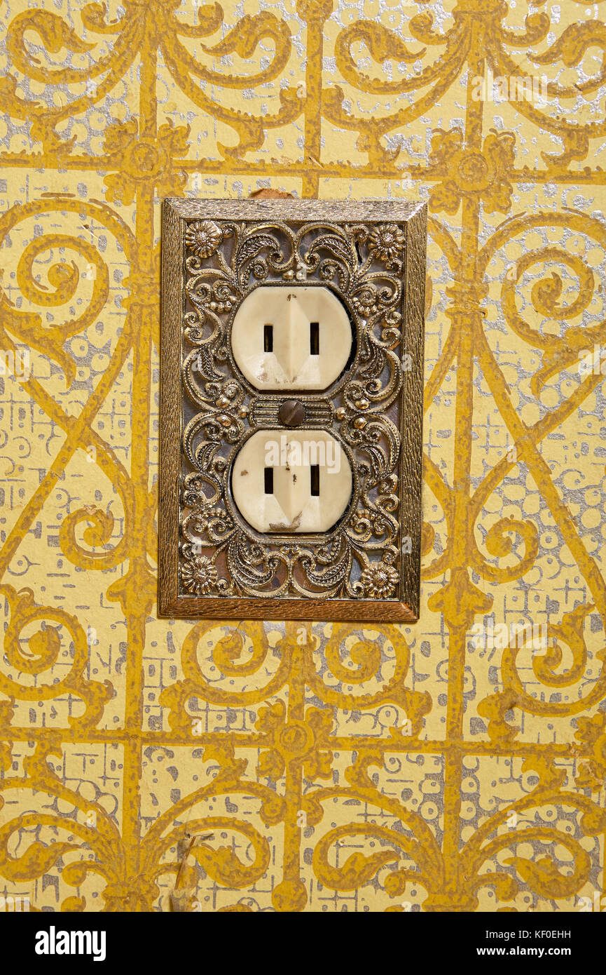 Close up of AC power plug installed in decorative yellow wall Stock ...