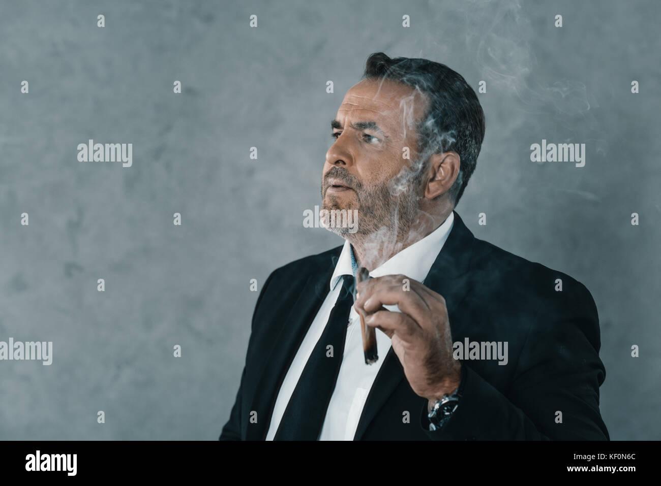 Businessman Smoking Cigar Stock Photos & Businessman