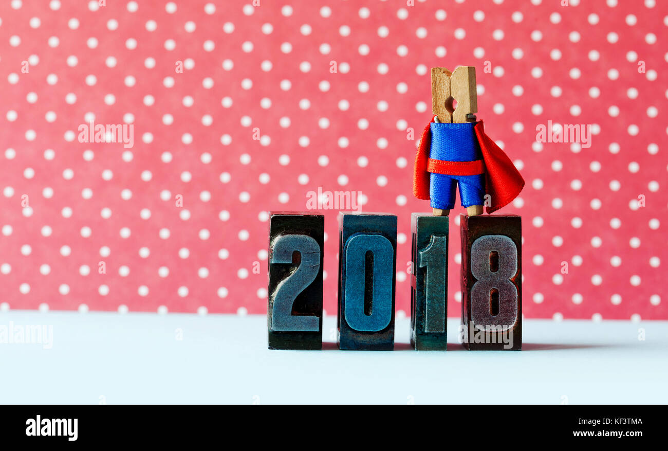 super successful 2018 new year card brave superhero leader posing on vintage letterpress digits beautiful clothespin metaphor character in red blue