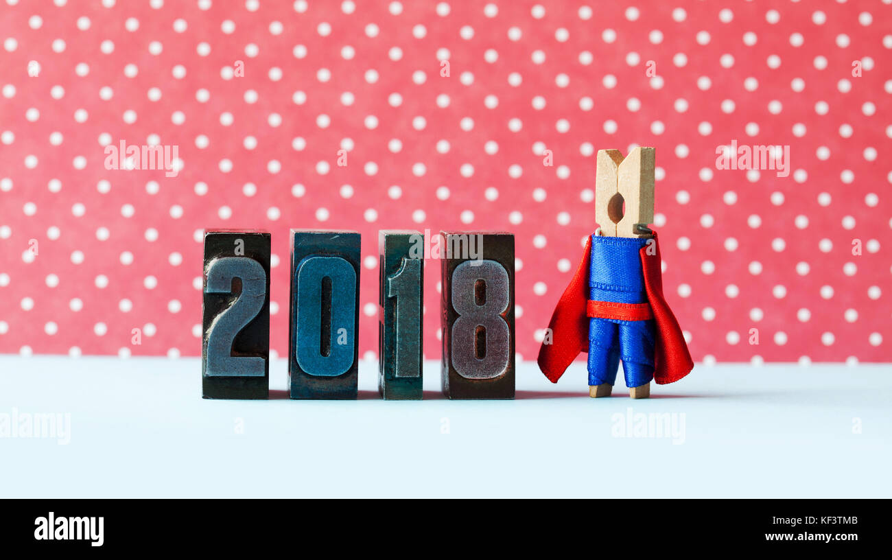super inspiration 2018 new year greeting card creative superhero leader posing near retro letterpress digits metaphor character in red blue costume