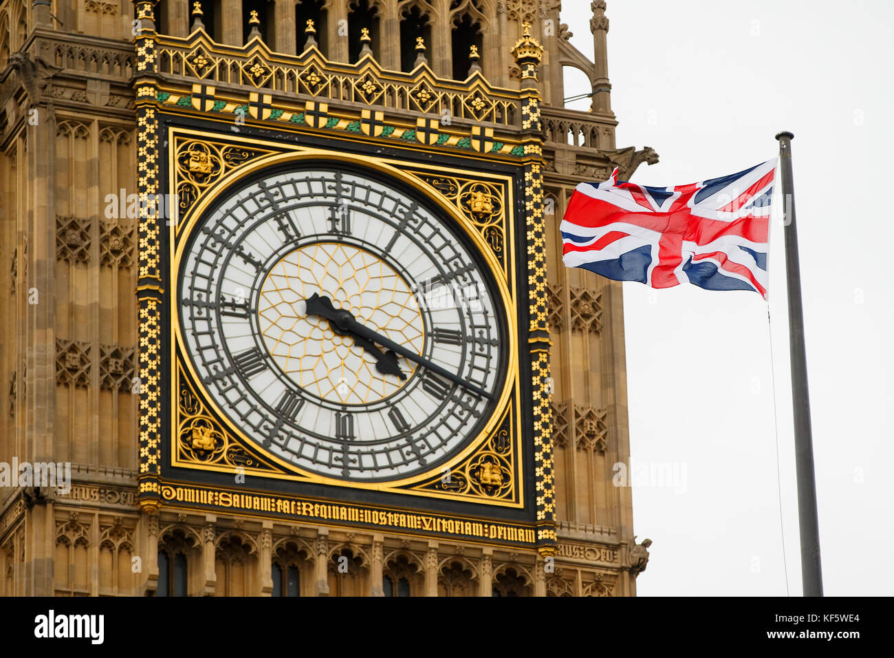 Union jack flag flies stock photos union jack flag flies stock a union jack flag flies in the wind with big ben the clock tower and amipublicfo Images