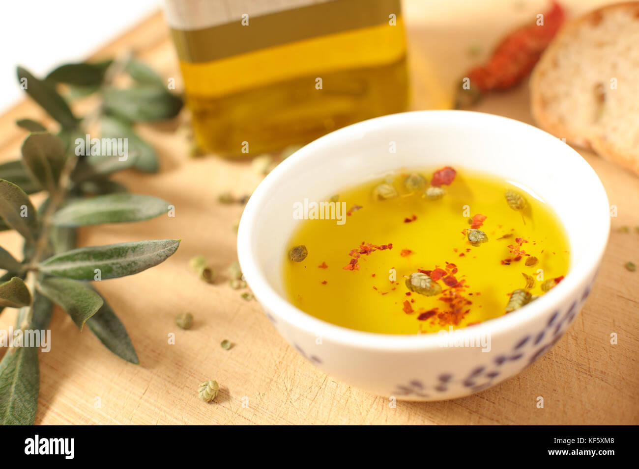 a1f5578a05fb Close up view of green and black olives in porcelain bowl with olive oil  with fresh bread