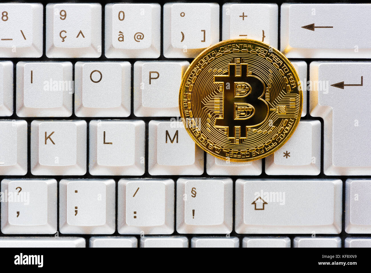 Golden Color Bitcoin On A Computer Keyboard Stock Photo 164309749