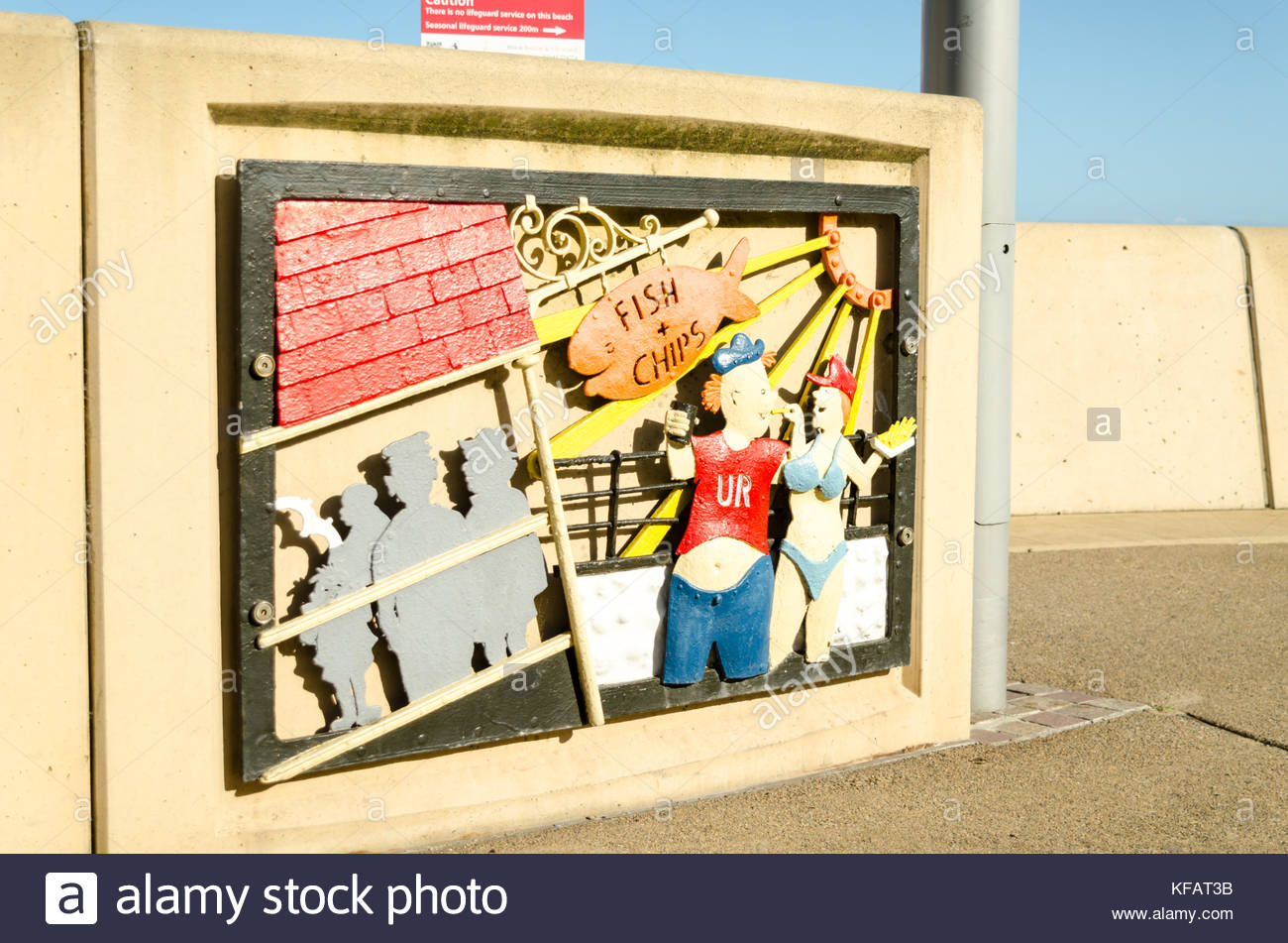 Metal Public Artwork Mural of a Tourist Couple at the Seaside Stock ...