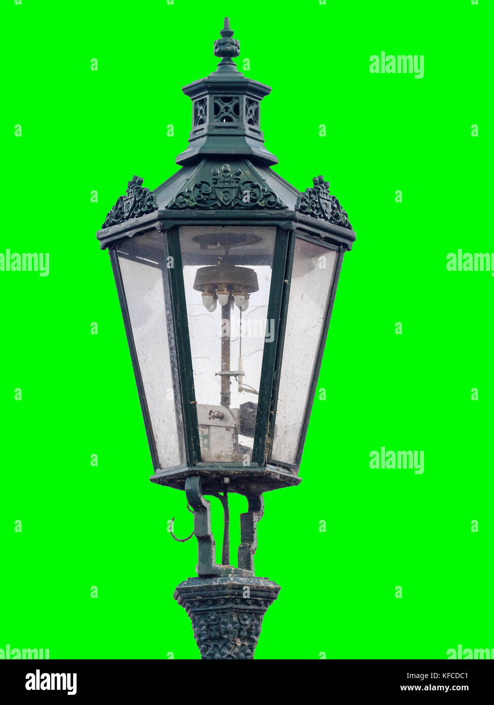 vintage street lamps in the old town of prague on green background