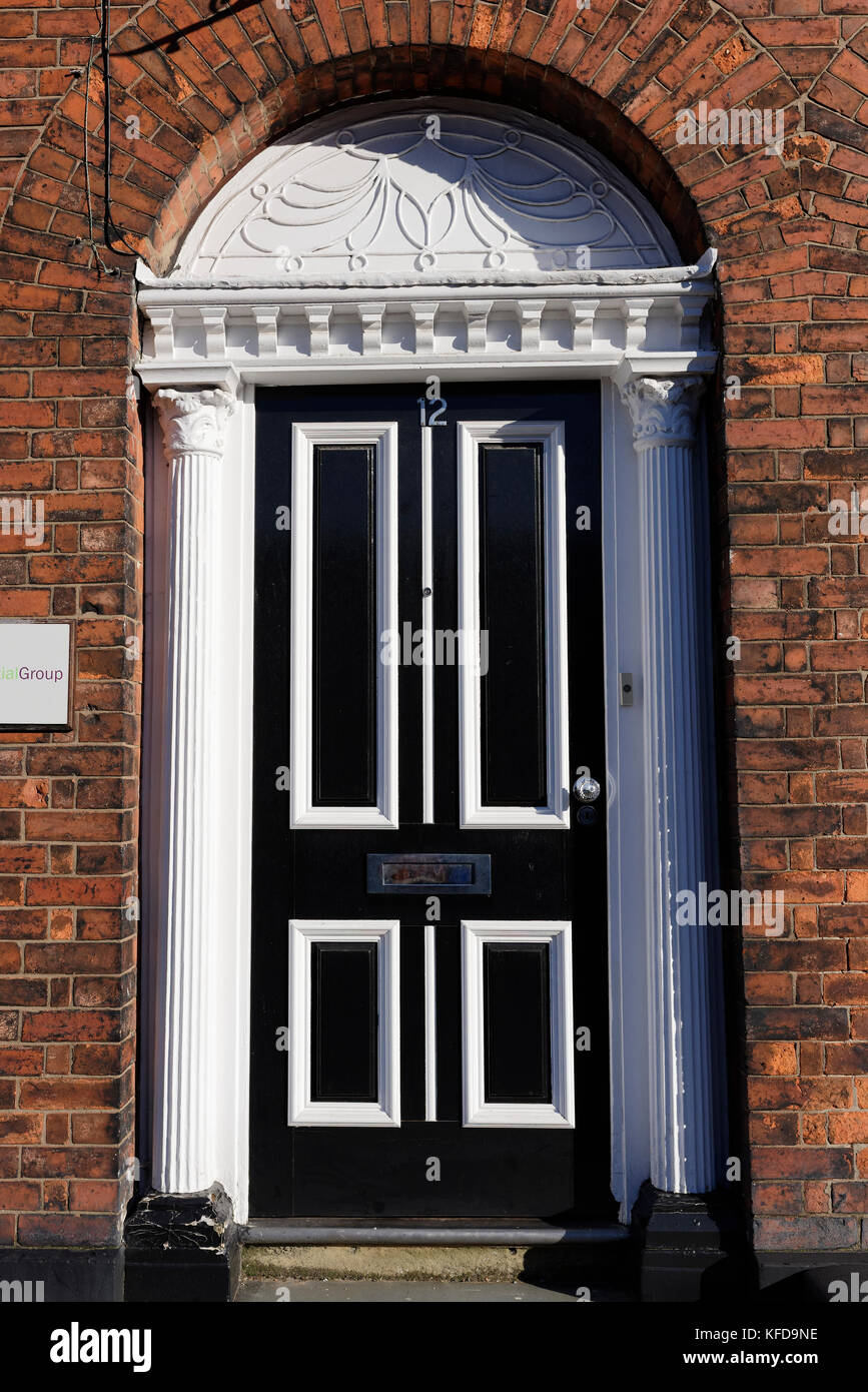 Ornate white wooden door casing with fluted pilasters and black and white four panel wooden door & Pilaster Stock Photos \u0026 Pilaster Stock Images - Alamy Pezcame.Com