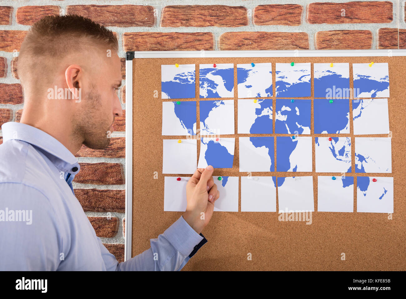 Businessman looking at world map made on notes over the bulletin businessman looking at world map made on notes over the bulletin board gumiabroncs Gallery