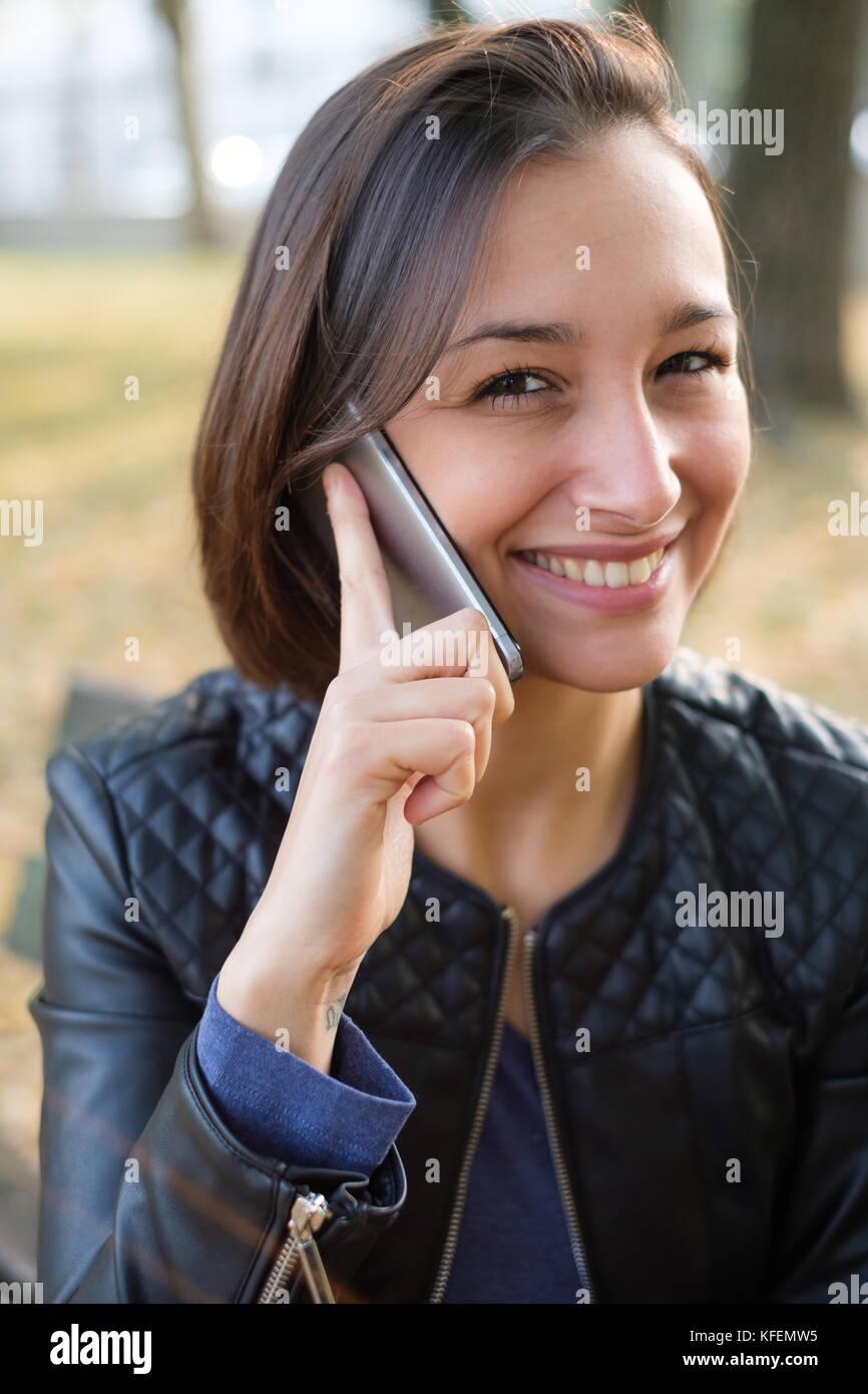 Young teen cell phone facial