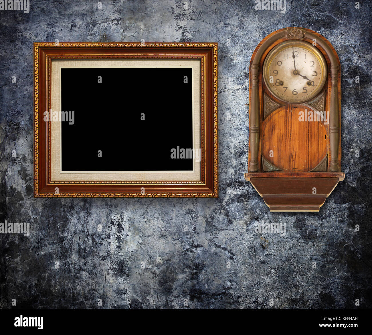 vintage wall frames. Vintage clock with Gold frames on Grungy wall Stock Photo