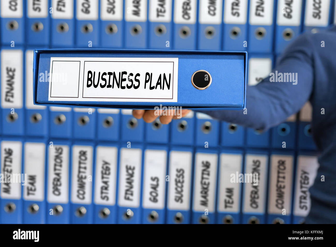 business plan management strategy concept young man holding ring