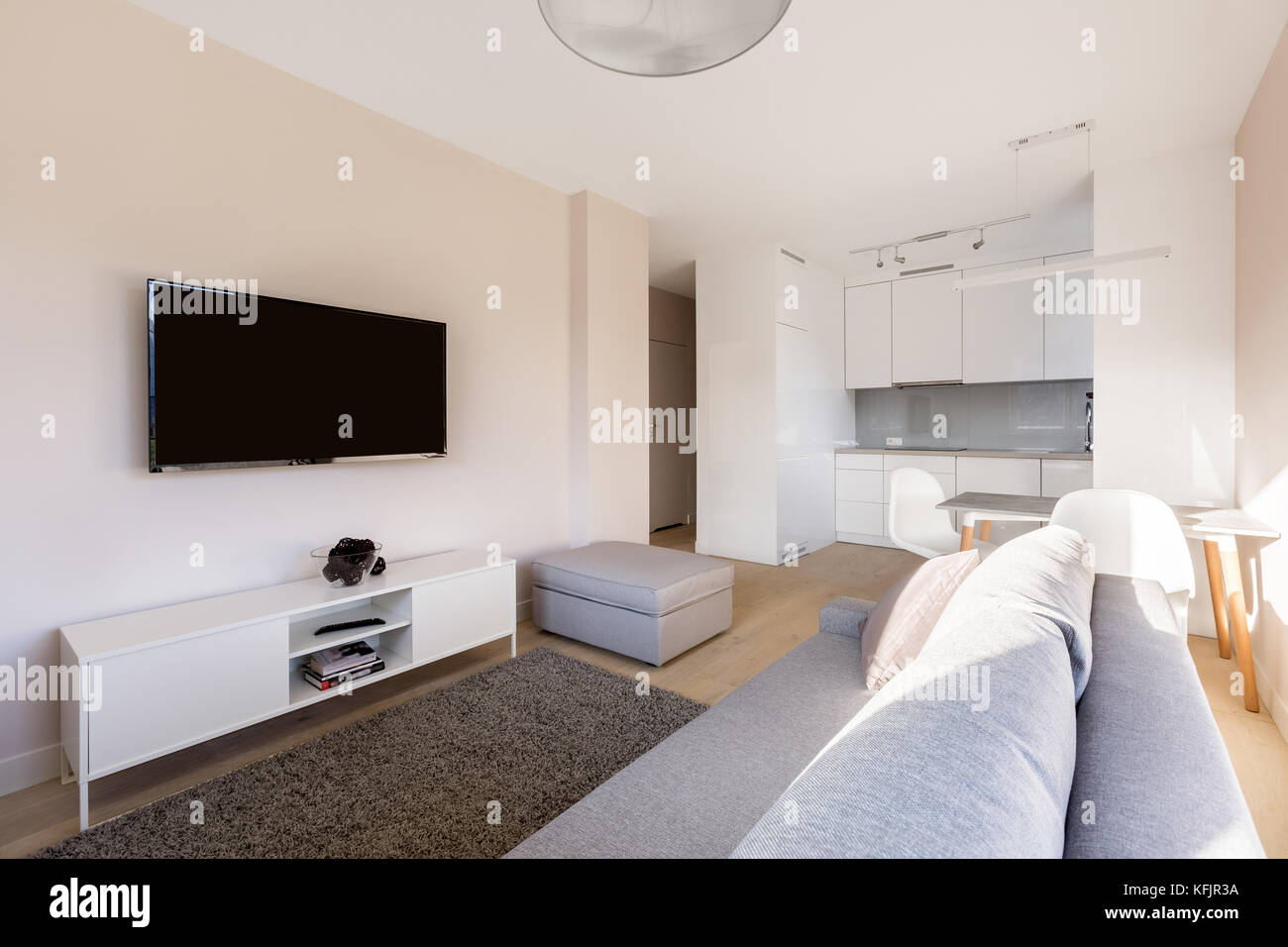 Studio flat with tv room and small kitchen Stock Photo ...