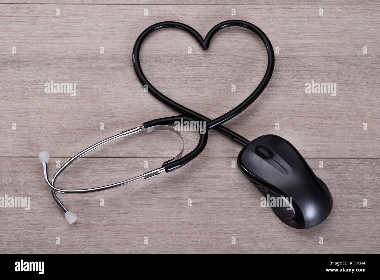 Stethoscope Forming Heart Shape In Online Medical Advice Concept
