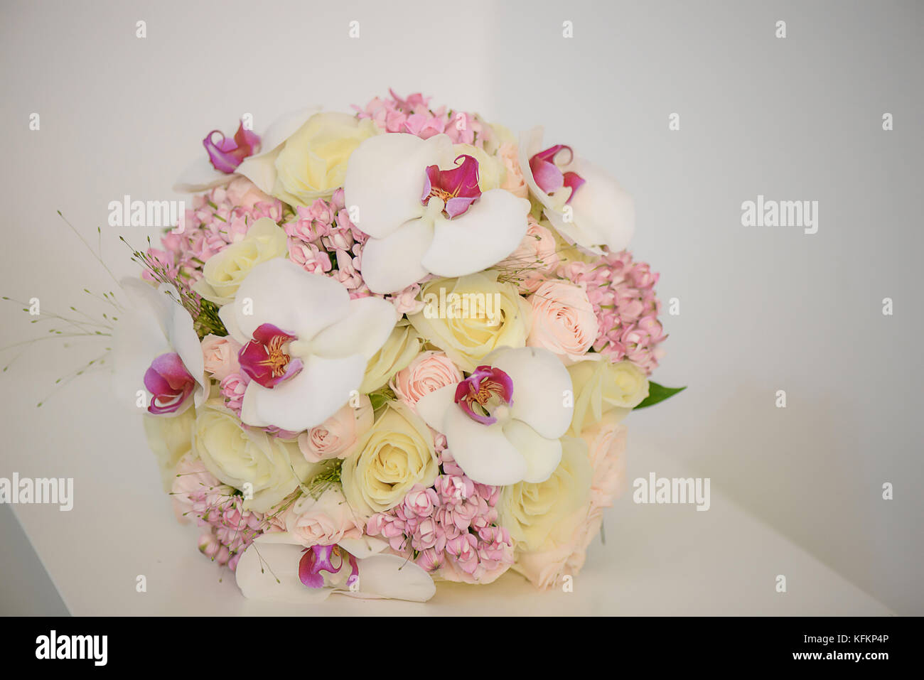 Exotic orchids, pale yellow and pink roses bridal bouquet. Wedding ...