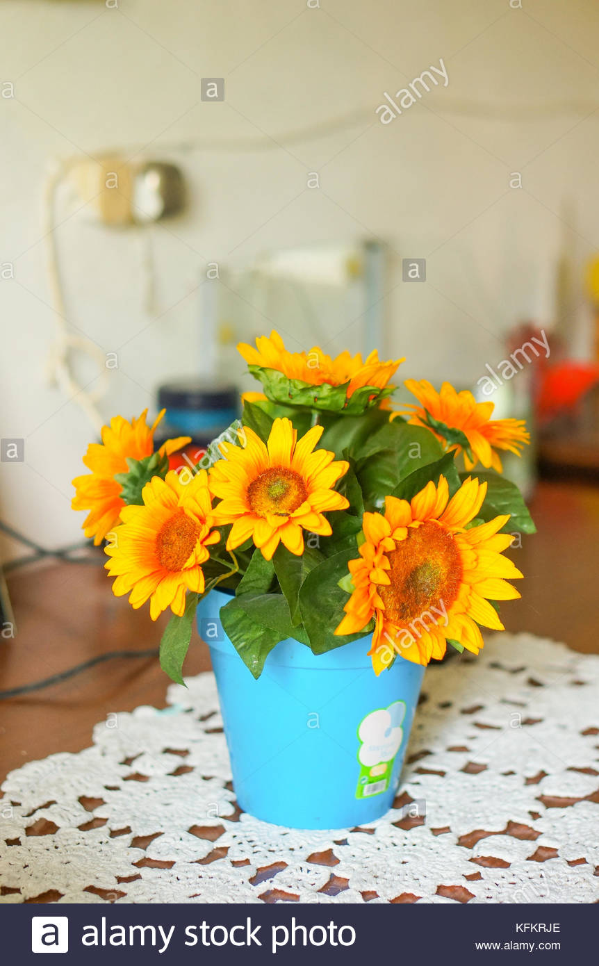 Carbonara di po italy april 17 2016 yellow fake flowers in a carbonara di po italy april 17 2016 yellow fake flowers in a pot with brand sticker on table mightylinksfo
