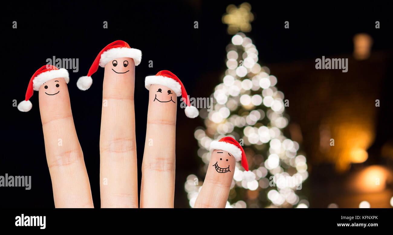 close up of fingers in santa hats at christmas Stock Photo ...