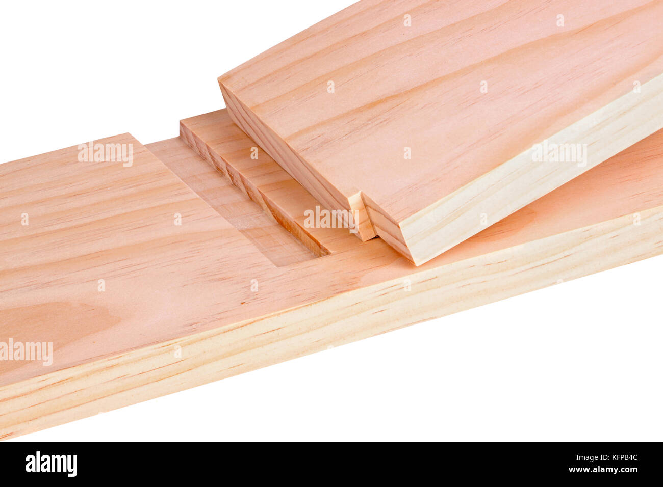 blind dado joint. close-up of two pine boards cut for a blind or stopped dado joint isolated